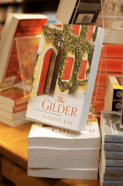 Red and white cover of a book The Gilder by Kathryn Kay