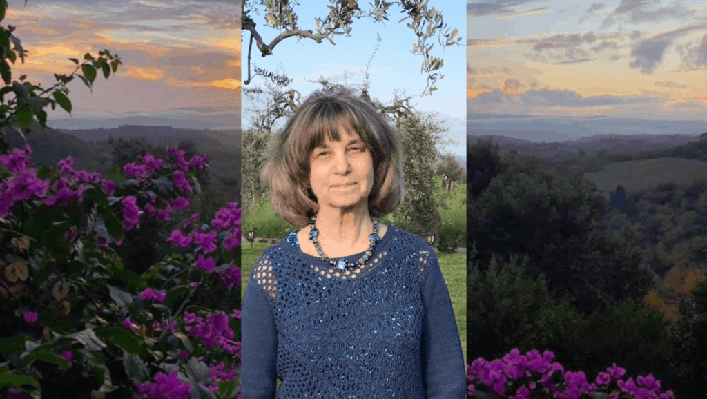 Woman writer in Tuscany surrounded by purple flowers