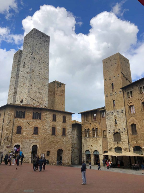 Stone towers of San Gimignano with piazza in the foreground