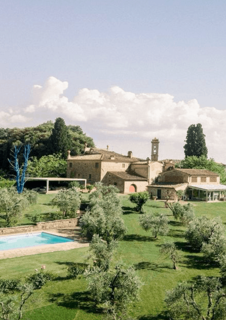 Aerial shot of A Writer Within's villa in Tuscany with pool in foreground