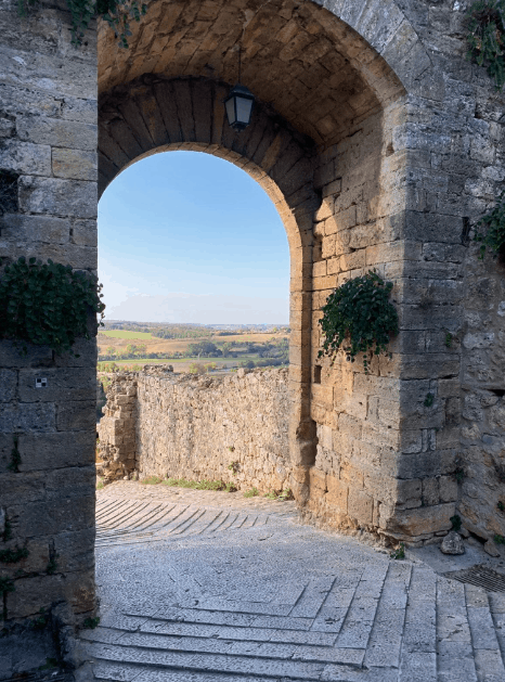 Stone archway with Blue sky at Monterriggioni, Italy