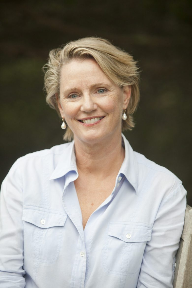 Writing coach and editor Kathryn Kay in blue shirt